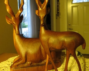Pair of Mid Century Carved Wood Gazelles (doe & fawn)