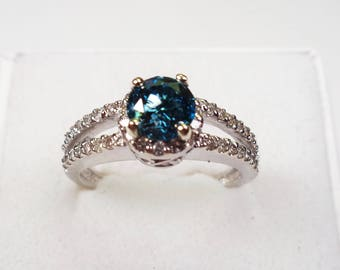 Blue Diamond in a  14kt. Gold White Ring.  Genuine.   81 Point 6mm. Round Blue Diamond in White Gold with s I Diamond Accents.