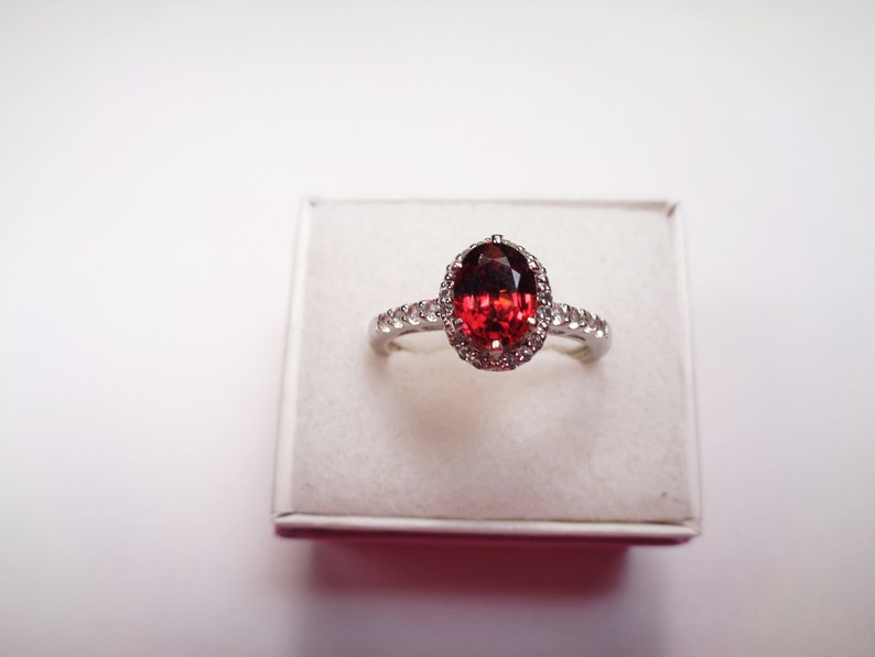 1.39 Carat  Oval Mozambique Garnet Silver Ring with topaz accents One of a Kind! 8 x 6mm