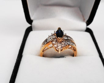 Sapphire Ring.  Natural Marquise Sapphire and Diamonds in a 10kt Yellow Gold Ring.