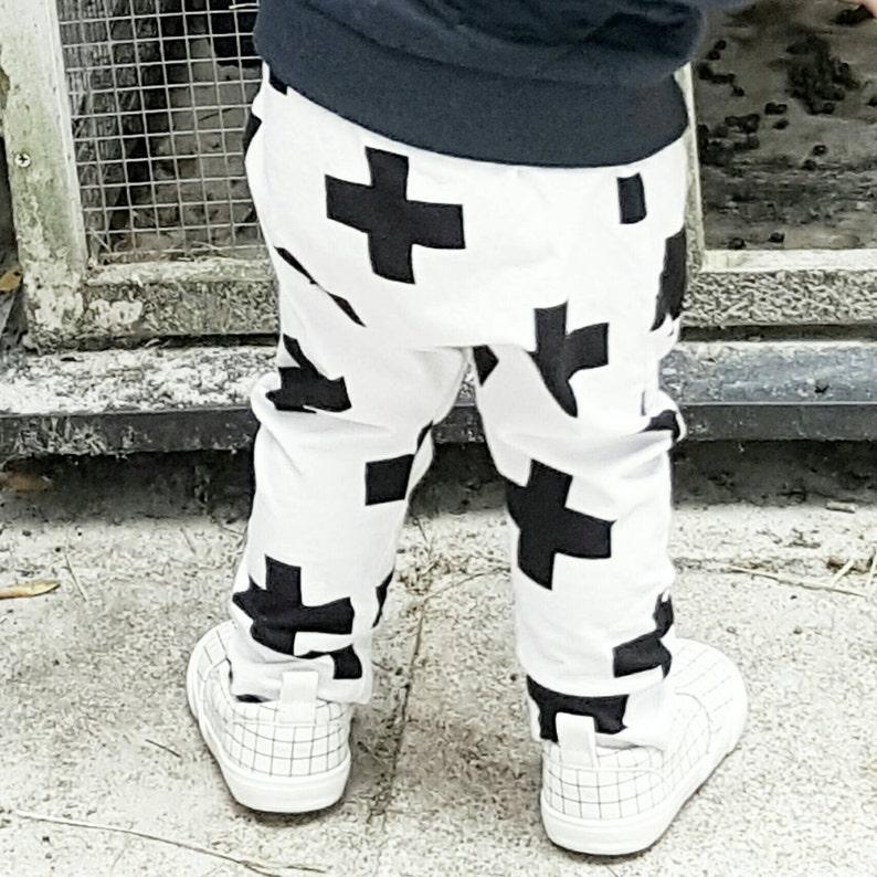 aba878ff3150 Baby harem pants w/ black white crosses Newborn apparel | Etsy
