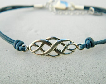 Leather and sterling silver bracelet.Good luck bracelet.Celtic knot beaded.Celtic knot bracelet.Celtic symbol bracelet.Leather bracelet.L023