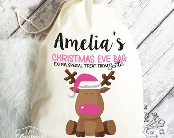 Christmas Eve Gift Bag with Pink Reindeer design. Personalised cotton bag with 4 sizes available.