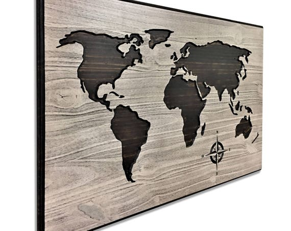 Carved wooden world map wood wall art world map home decor etsy image 0 gumiabroncs Choice Image