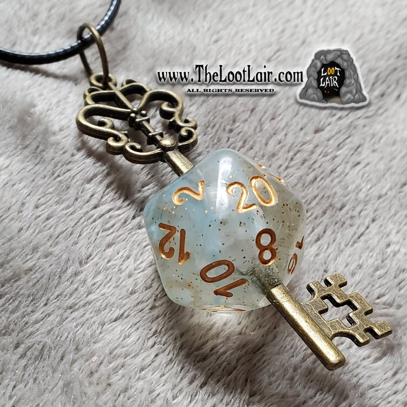 2.5 Inch Antique Bronze Ornate Key plunged through a Clear Star-filled Pastel Green Nebula D20 NecklacePendant D/&D Crit RollFumble Proof
