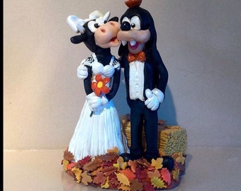 Wedding cake topper.-   Novelty bride and groom figures made from everlasting polymer clay -  Cake topper plus unique keepsake