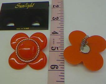 Flower shaped Orange Clip Earrings