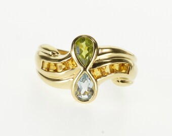 10k Pear Peridot Blue Topaz Citrine Accented Wavy Ring Gold