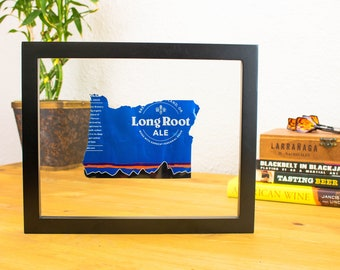 Oregon- Long Root Ale Beer Can Handcut into the shape of Oregon. Hung in a float frame. Perfect for your bar or man cave! Oregon Pride!