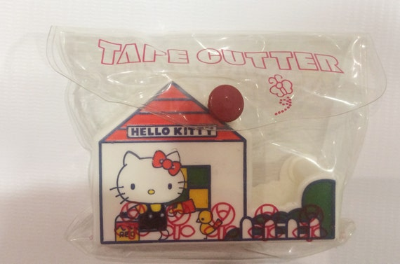 1064995255f9 Vintage Hello Kitty tape cutter Sanrio made in Japan