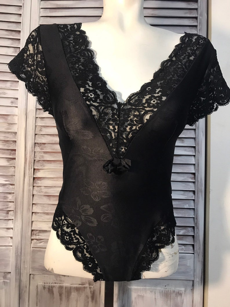 Lingerie a vintage piece 80 stade fully elastic nylon and lace black small size