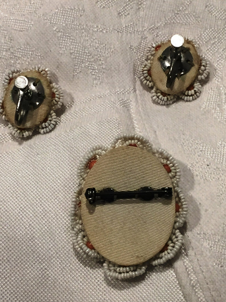 Celluloid cameo brooch and matching screw back earrings with hand beading