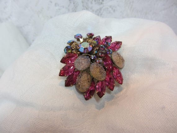 Vintage Pink Brooch Featuring Gold Tone Riveted Fr