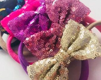 Newborn bow headband. Nylon baby headbands. Sparkle bow. Sequin Bow headbands . Glitter baby bows