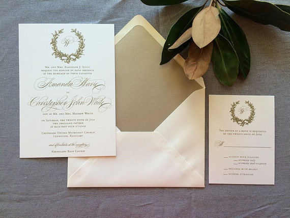Magnolia Wreath and Monogram wedding invitation in gold ink