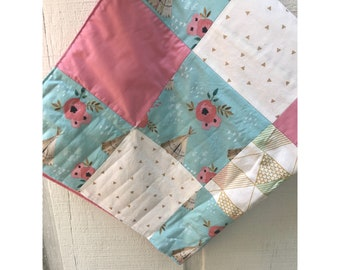 Baby sized quilt pink and blue and gold