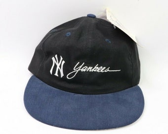 19c8233f06365 90s Deadstock Drew Pearson New York Yankees Baseball Spell Out Leather Strapback  Hat Youth Size