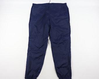 e5a35024671ed2 90s Nike Spell Out Nylon Joggers Jogger Pants Navy Blue Mens 2XL XXL