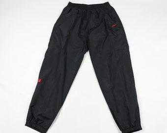 41a9f09fccc1 90s Reebok Casual Spell Out Nylon Joggers Jogger Pants Black Mens XL, Vintage  Reebok Nylon Joggers, Vintage Pants, Vintage Joggers,
