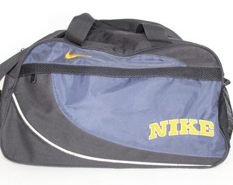 872b3b6cc977 90s Nike Spell Out Weekender Nylon Carry On Travel Bag Blue