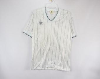 3de8216ae 80s New Umbro Mens Large Spell Out Short Sleeve Soccer Jersey White Green