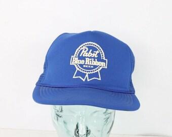 f57fb14ddaa3f 80s Pabst Blue Ribbon PBR Beer Spell Out Roped Snapback Trucker Hat Blue