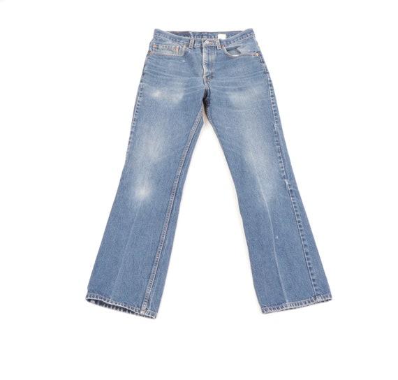 90s Levs 517 Distressed Faded Boot Cut Denim Jeans