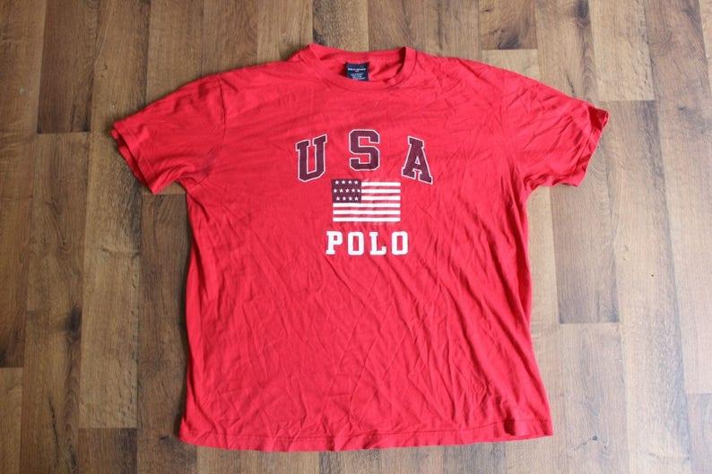 7a5ff1fb2 90s Polo Sport Ralph Lauren USA Flag Spell Out Short Sleeve