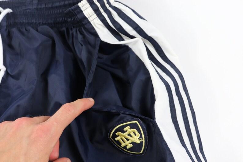 90s Adidas Notre Dame University Spell Out Nylon Joggers Pants Mens 3XL , Vintage Adidas Notre Dame Fighting Irish Joggers, Adidas Pants,