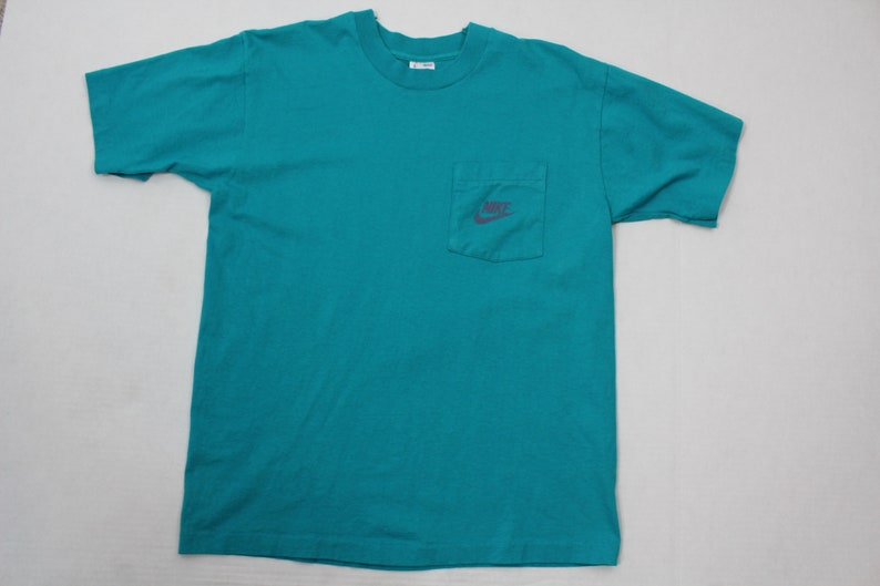 86079ef963da 90s BVD x Nike Spell Out Custom Short Sleeve Pocket T-Shirt