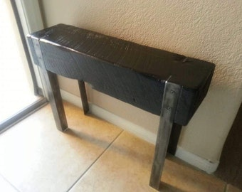 Upcycled wood beam and angle iron entryway bench
