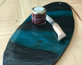 """Teal and black skateboard 