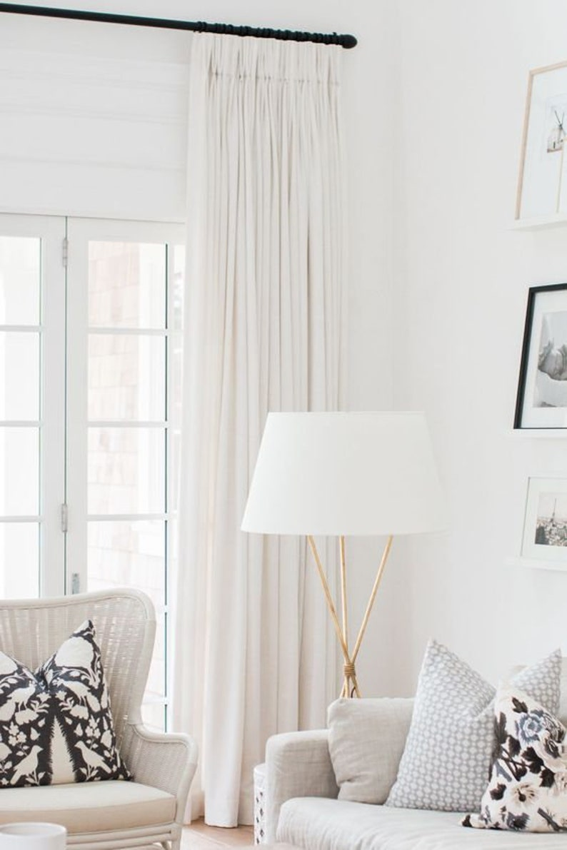 This living room with serene decor features Belgian linen curtains made custom by this Etsy shop.