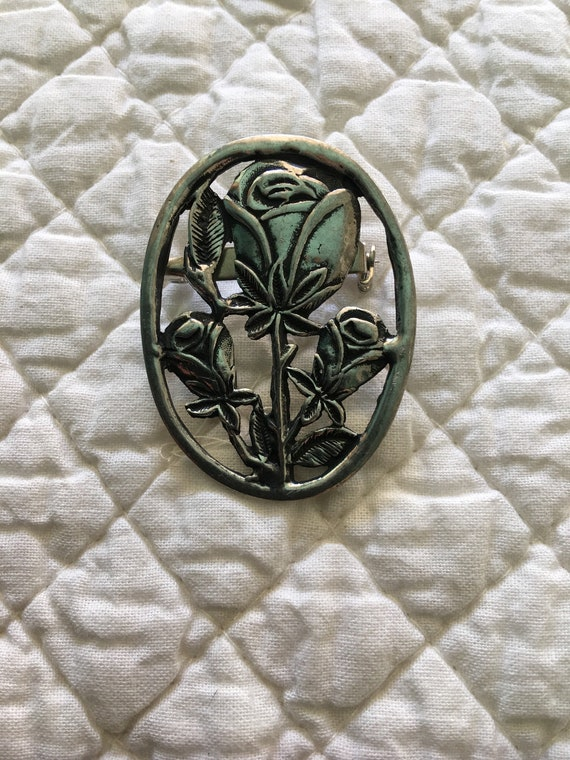 Silver brooch with rose