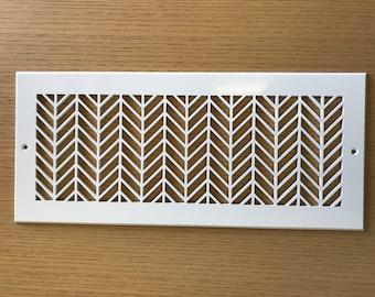 Semi-gloss white, herringbone pattern decorative vent cover