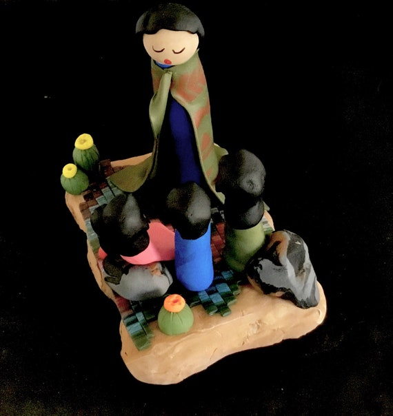 Storyteller on Wood Base