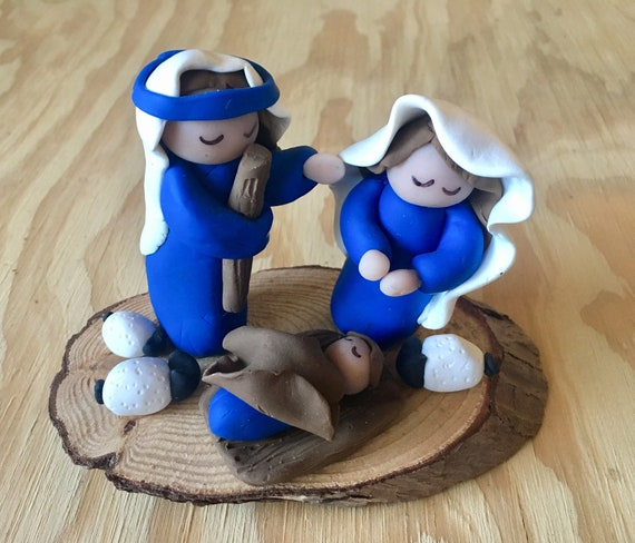 Blue and White Clay Nativity on Wood Base
