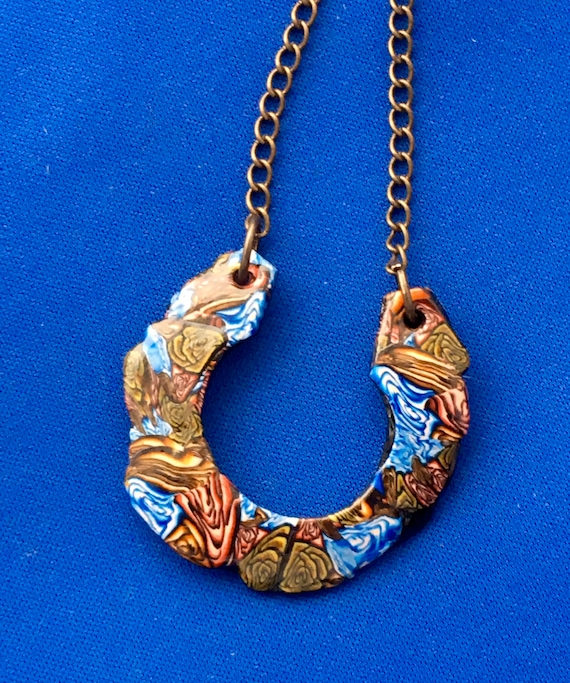 Handcrafted Polymer Clay Horseshoe Shape Pendant