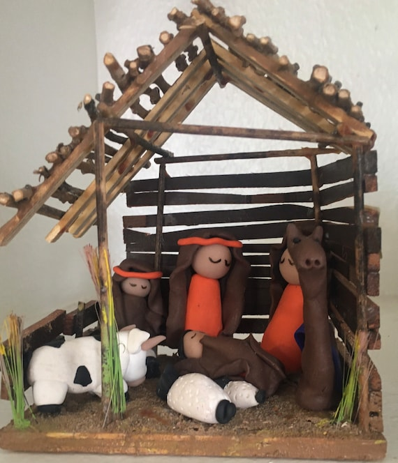 Clay Nativity in Wooden Stable