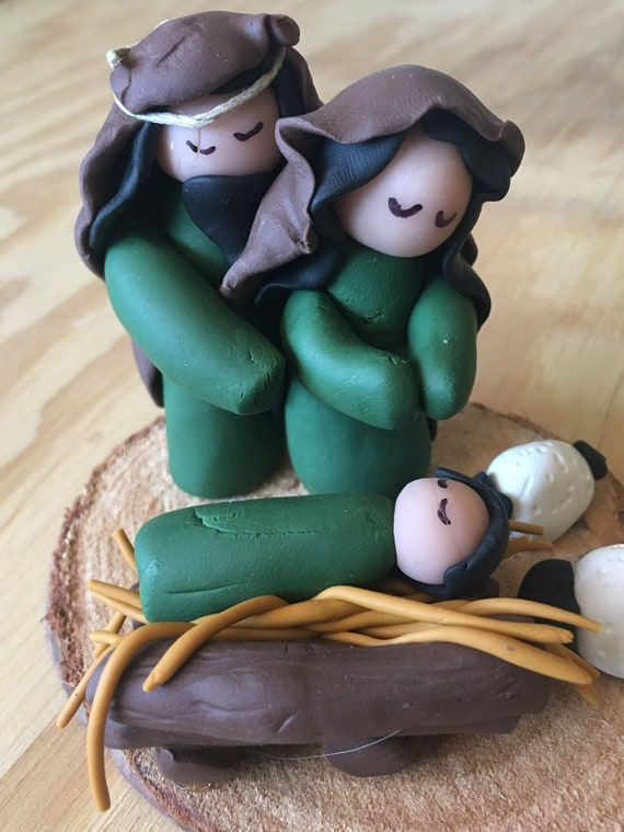 Green and Brown Clay Nativity on Wood Base