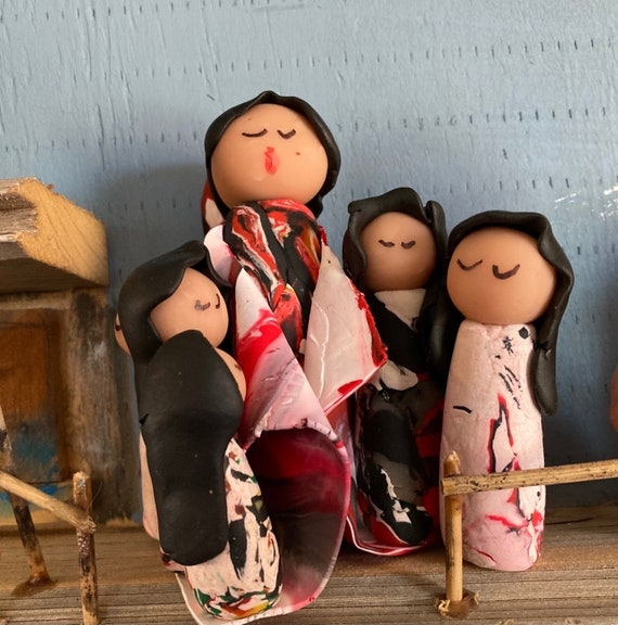 Storyteller in Polymer Clay in Red, Black and White