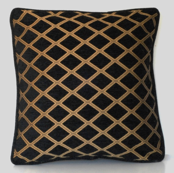 solid black complete decorative throw pillow with gold fringe for sofa or chair