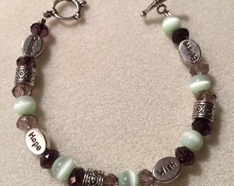 """Bracelet, """"Inspiration"""", in Sage Green/White and Purple Beads"""