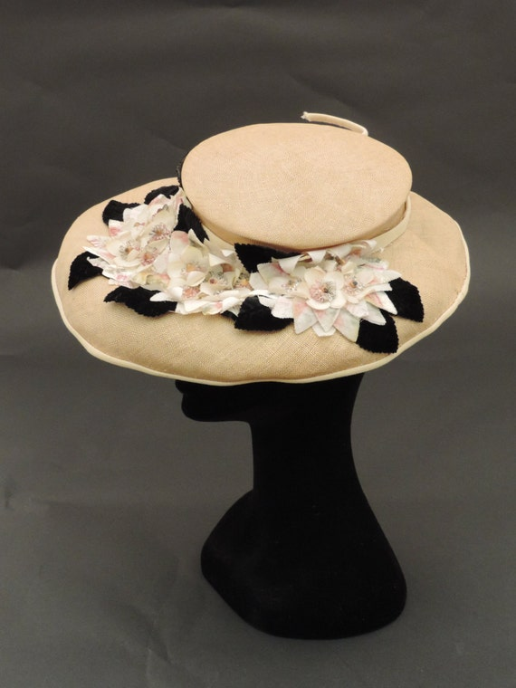 Wide-brimmed straw hat and 1940s flowers