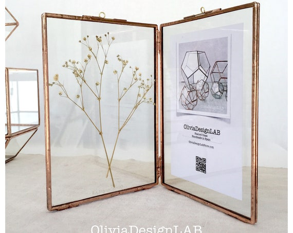 Diptych glass frame 7 x 5 inches each frame. Double frame, handmade stained glass frame, stands by itself. Silver, copper and black finish.