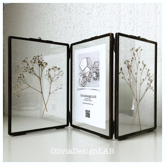 Triptych glass frame 7 x 5 inches each frame. Triple frame, handmade stained glass frame, stands by itself. Silver, copper and black finish.