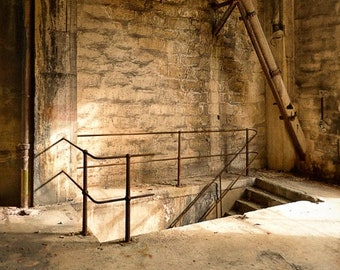 Staircase of an old abandoned factory. Industrial decay.