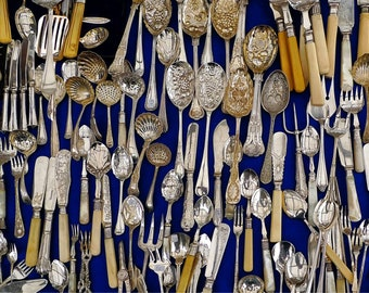 Old silver cutlery. Silver spoons and forks.