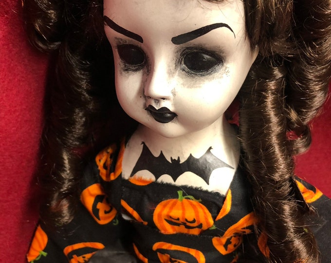creepy sitting girl doll with bat on chest pumpkin shirt spooky ooak gothic horror halloween art by christie creepydolls