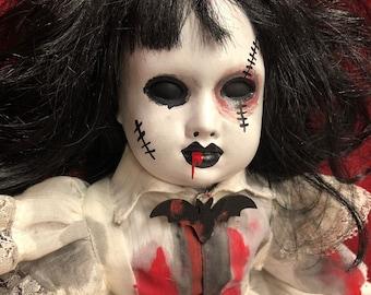 creepy doll sitting bruised eye bloody girl bat brooch spooky ooak gothic horror halloween art by christie creepydolls